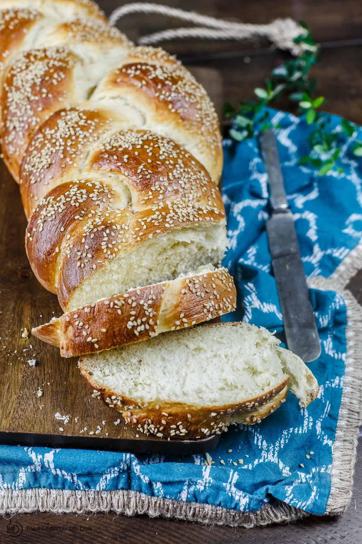 Challah bread sliced onto a board