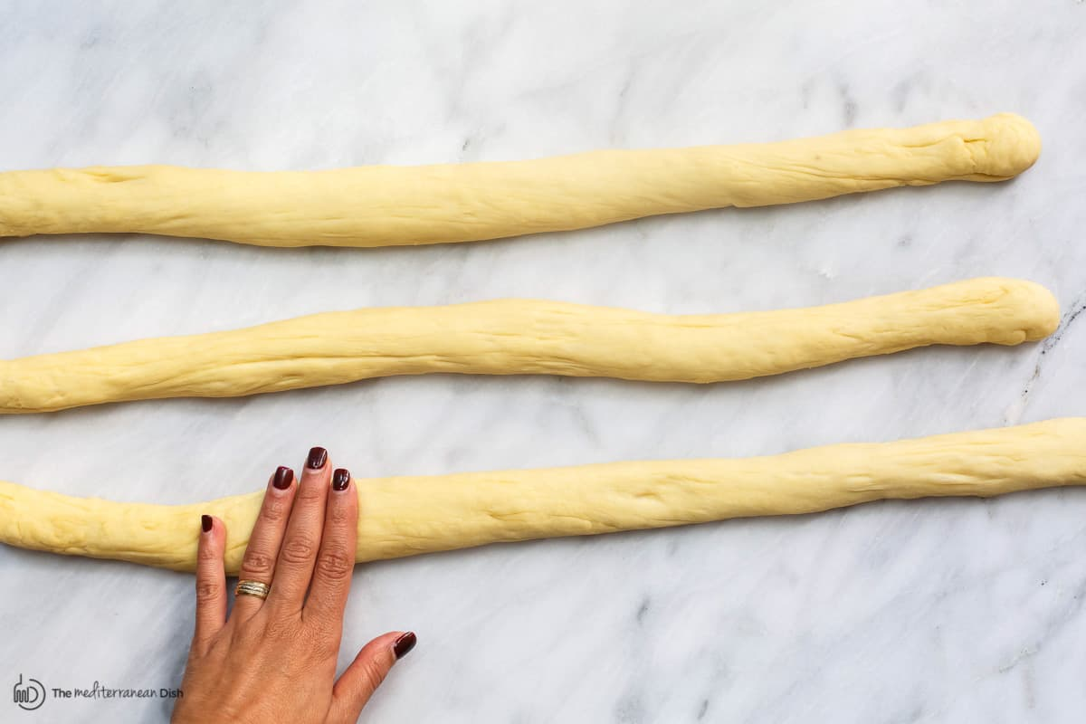 Rolling braids for challah bread