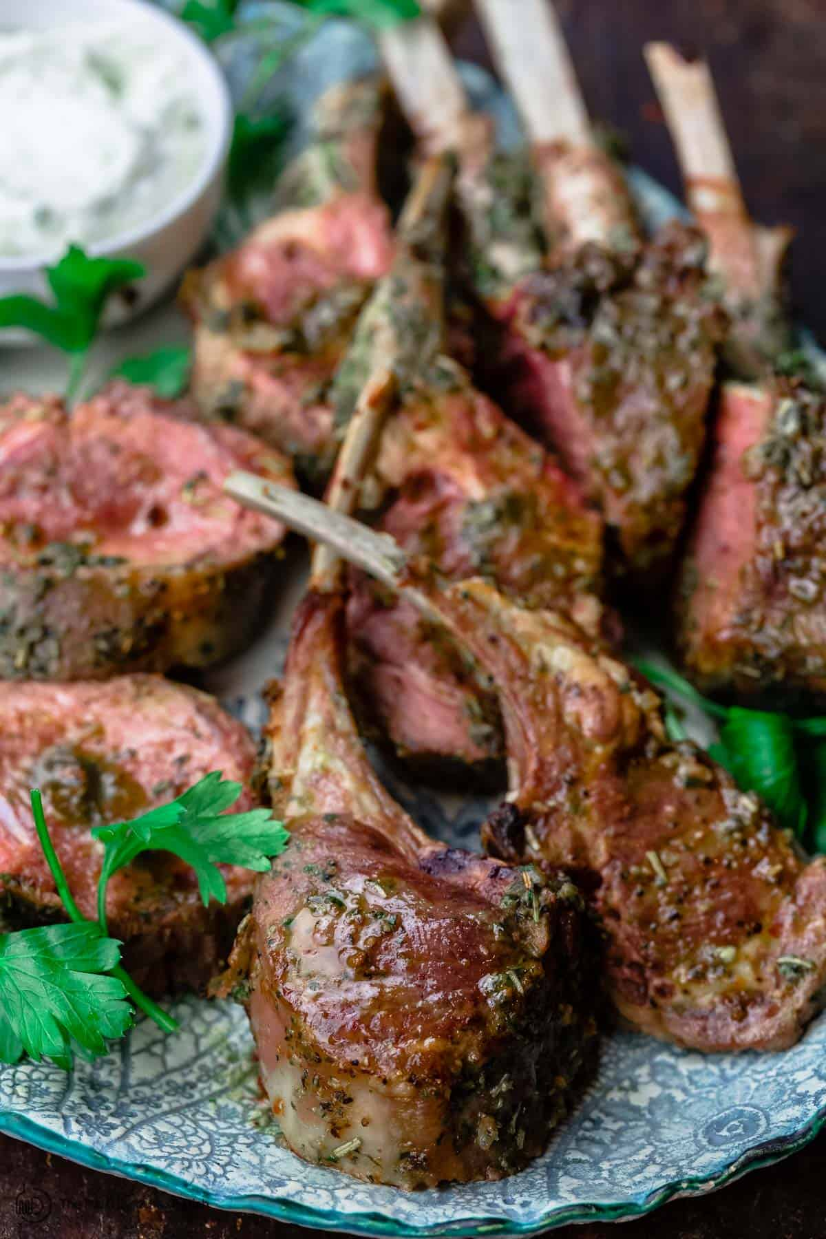 Roast Rack of Lamb cut into chops with a side of tzatziki sauce