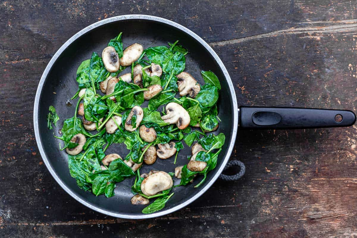 mushrooms and spinach in a nonstick pan