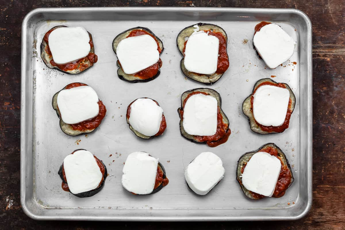 eggplant slices topped with marinara sauce and mozzarella cheese