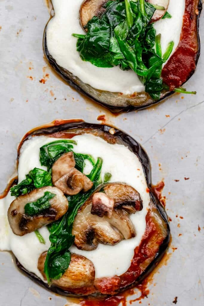 eggplant pizza bites topped with mushrooms and spinach