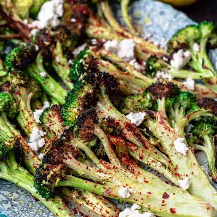 roasted broccoli with lemon wedges on the side