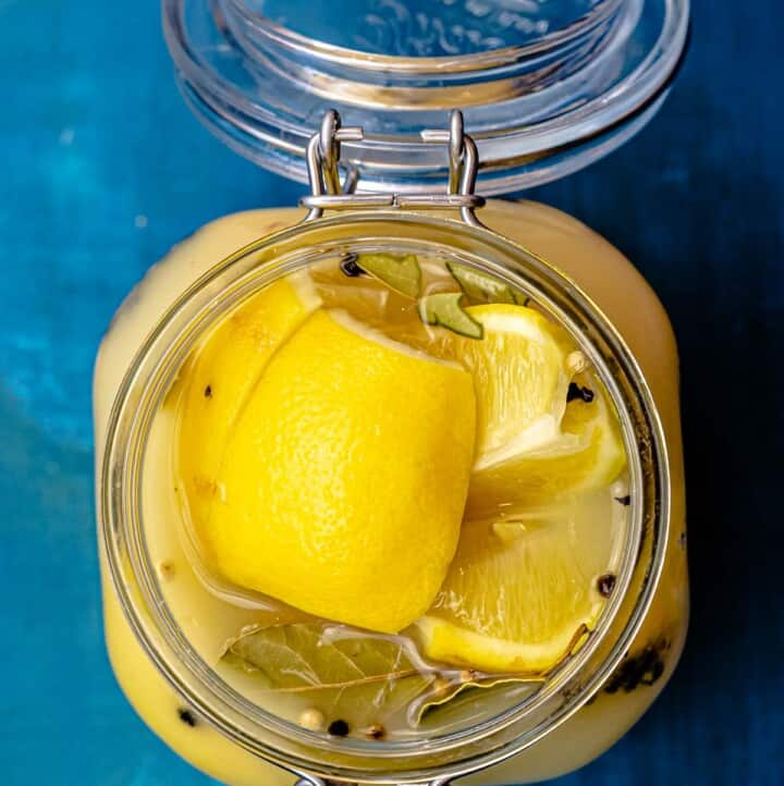 Top down picture of preserved lemons in a jar