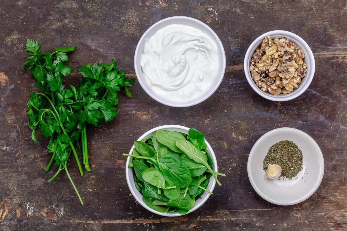 ingredients for Greek yogurt spinach dip in separate bowls