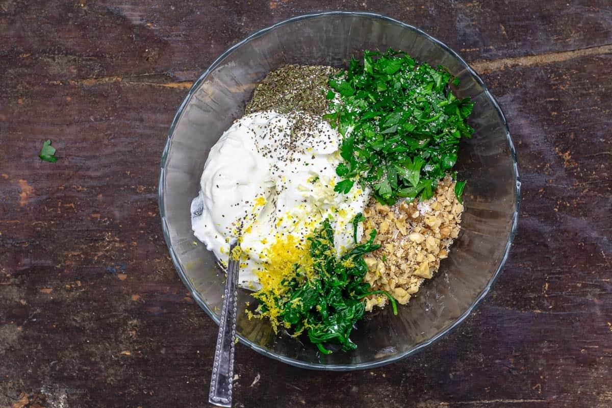ingredients for Greek yogurt spinach dip in one bowl