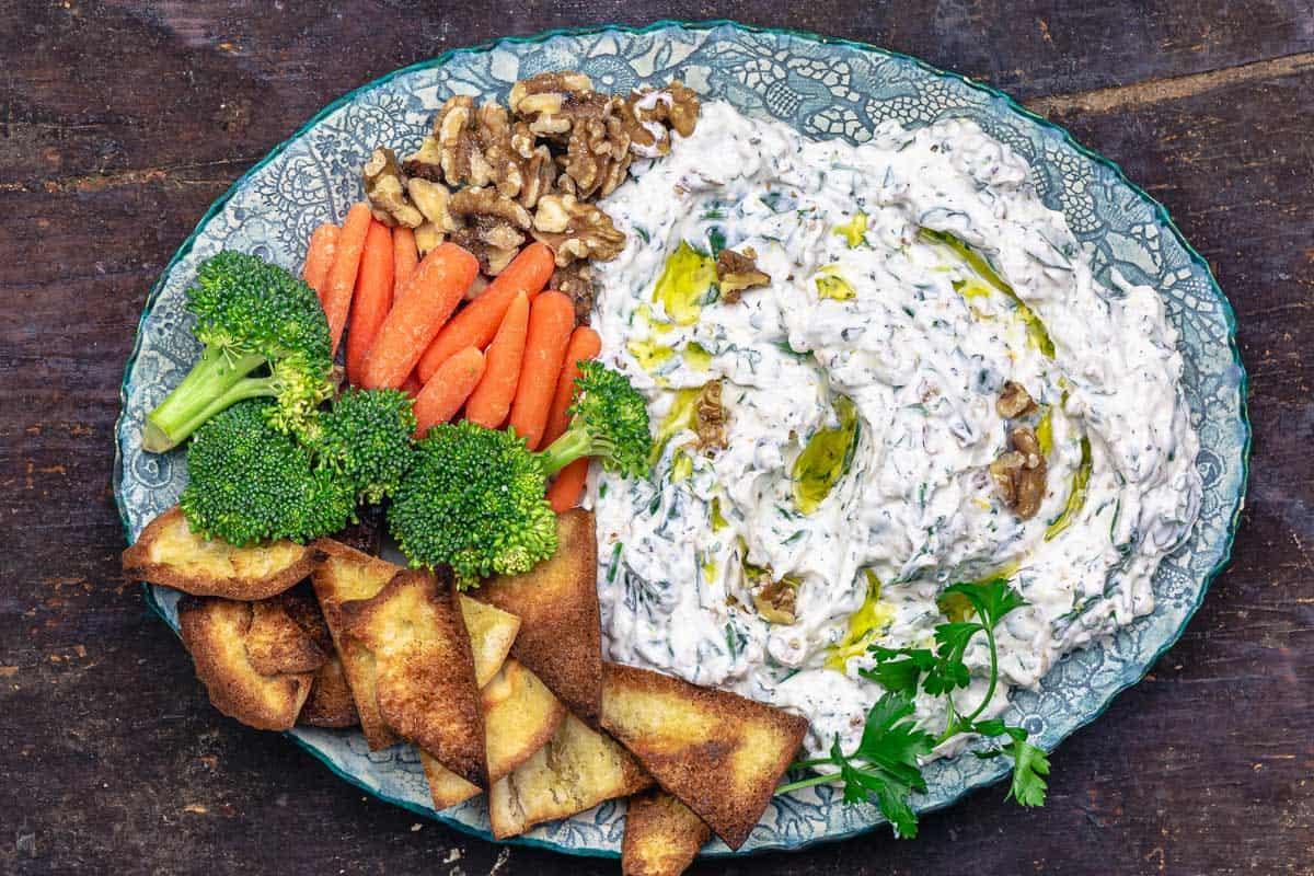 Greek yogurt veggie dip served with fresh veggies and homemade pita chips