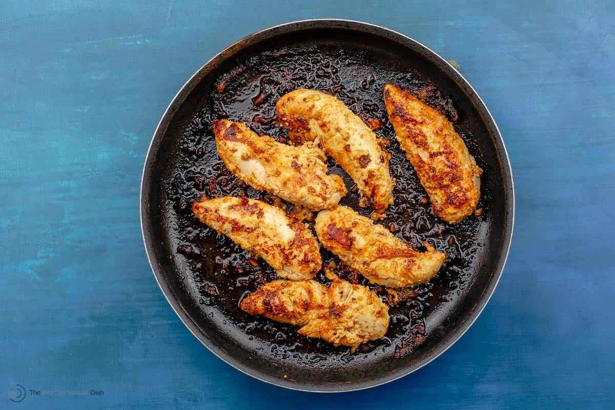 Chicken breasts cooked in a frying pan