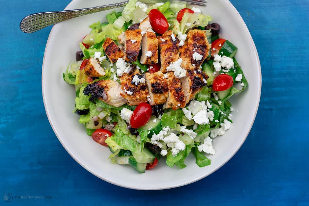 Greek chicken salad served in a white bowl