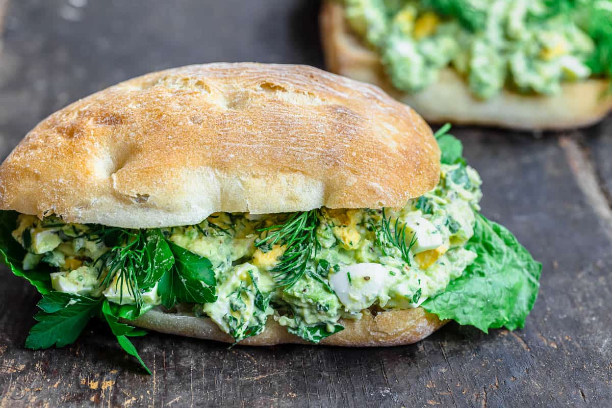 Avocado egg salad sandwich placed on a table