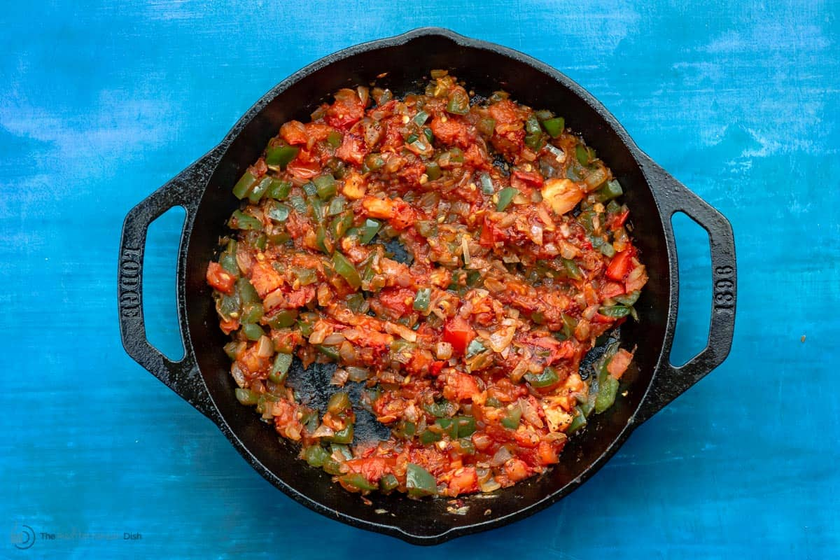 Sautéed vegetables and tomatoes in skillet