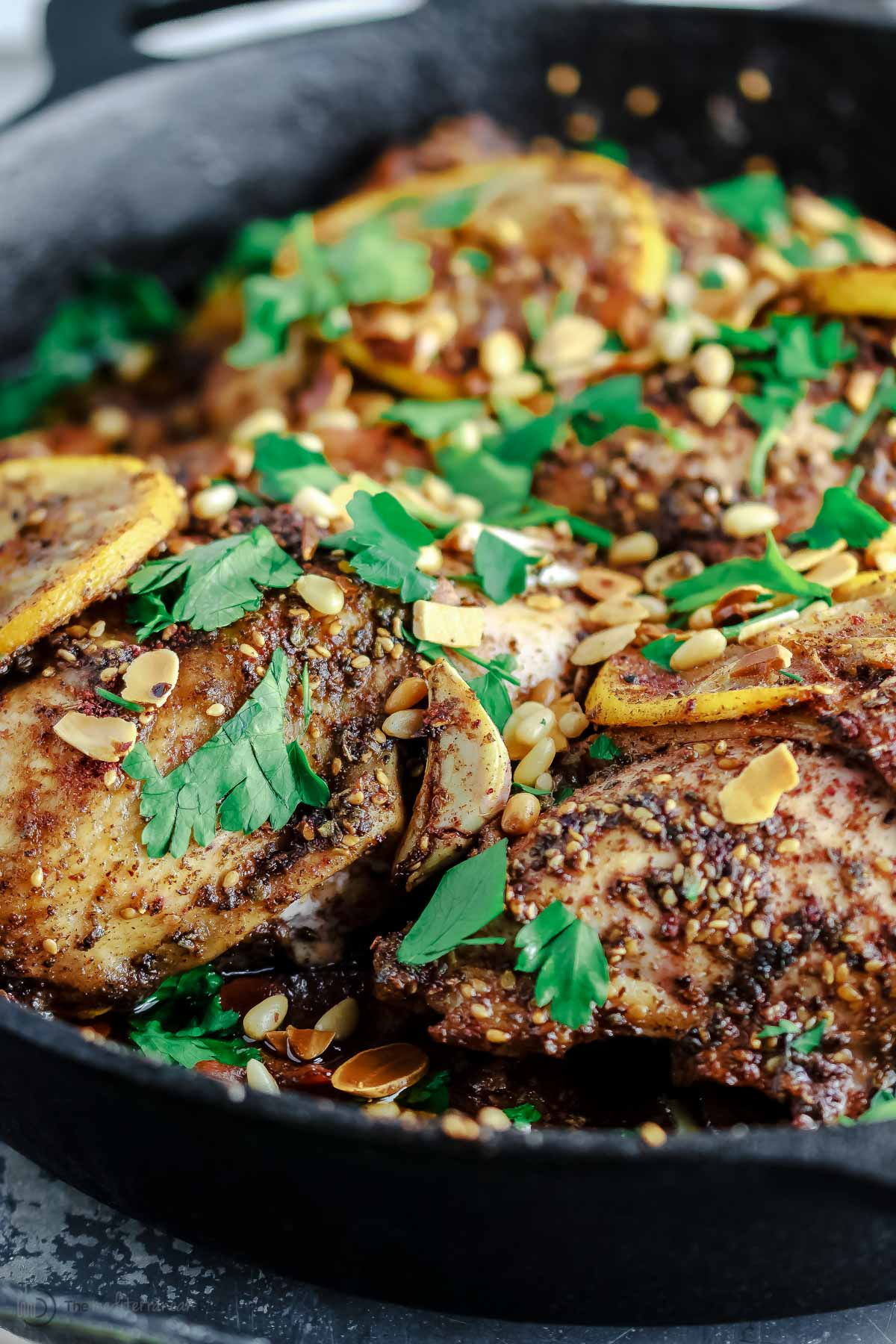 Angle picture of za'atar roasted chicken in a skillet