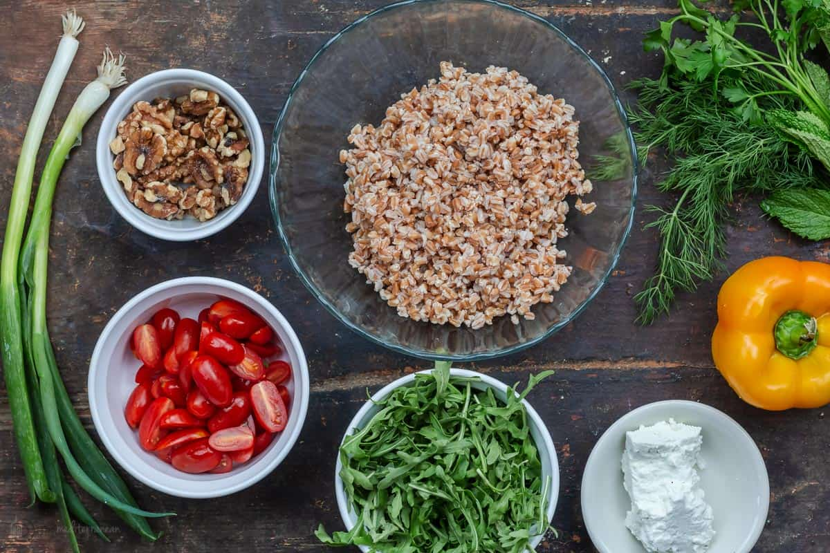 Ingredients for farro salad recipe in separate bowls