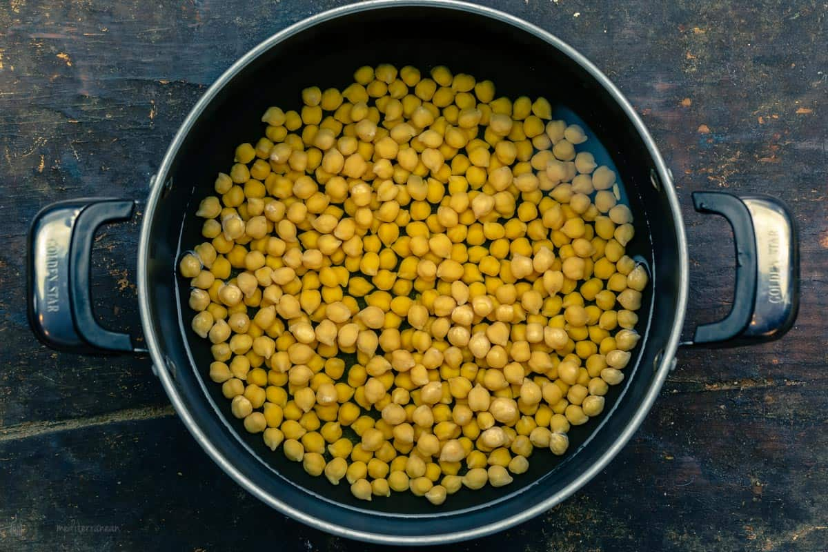 Chickpeas soaked in a pot of water