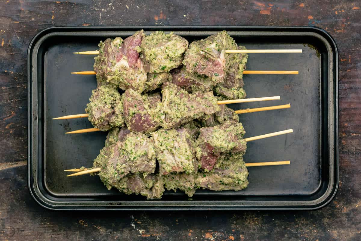 lamb kabobs skewered and placed in a tray