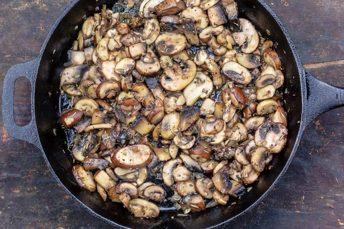 Mushrooms sautéed in cast iron skillet
