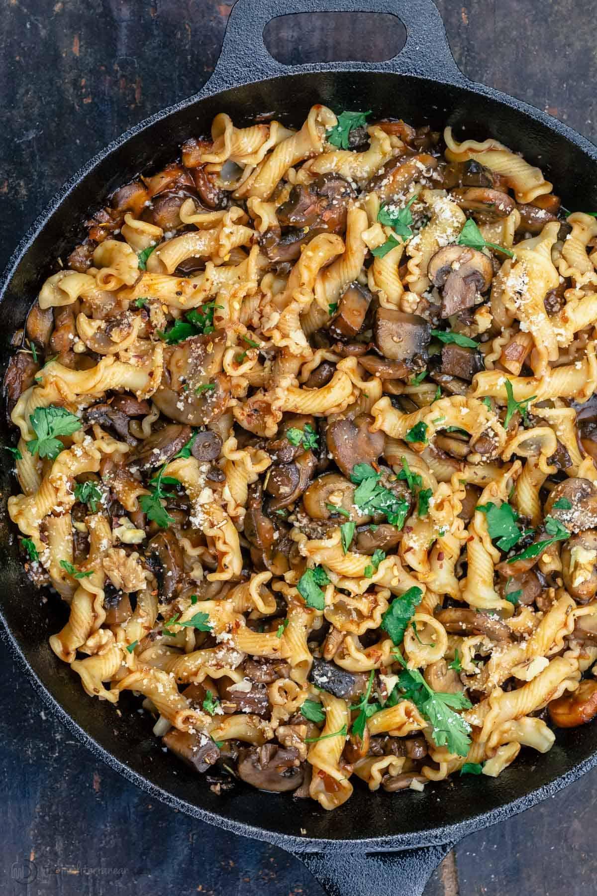 A skillet with mushroom pasta