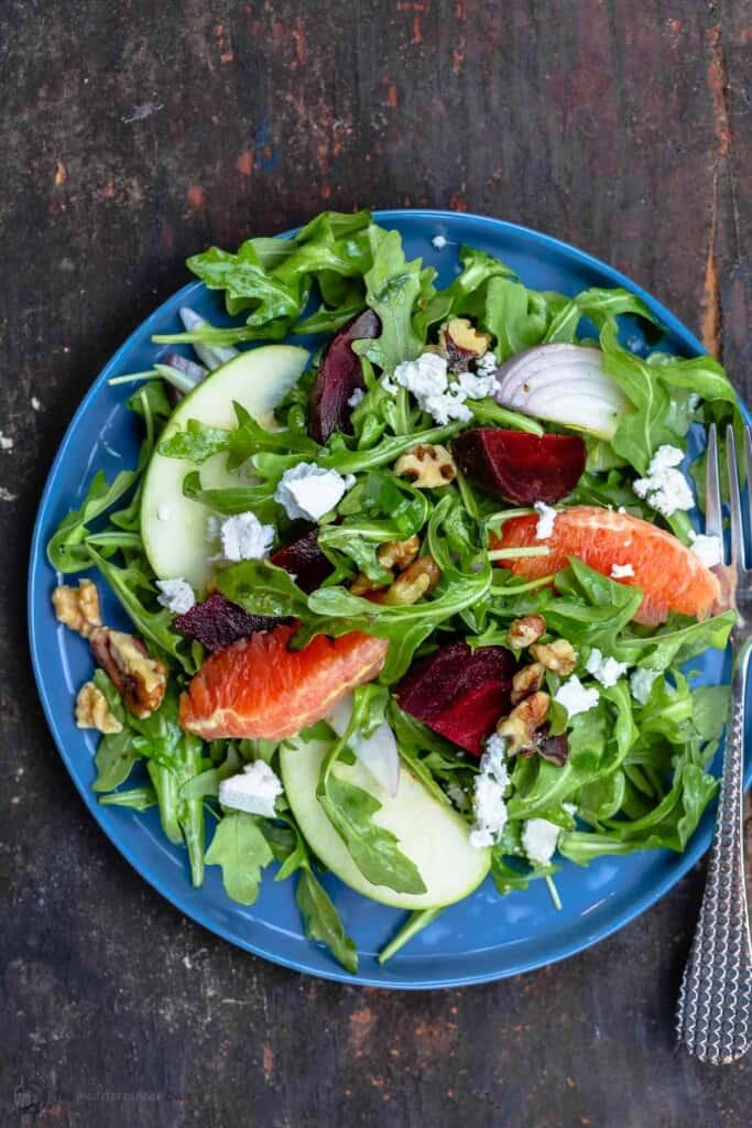 Beet salad served on a blue plate