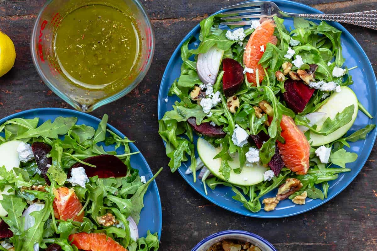 Orange beet salad with arugula served on a plate