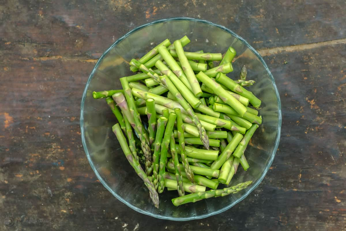 Asparagus pieces in a glass bowl