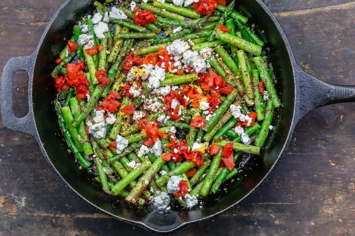 Mediterranean sautéed asparagus with feta lemon and garlic in a skillet