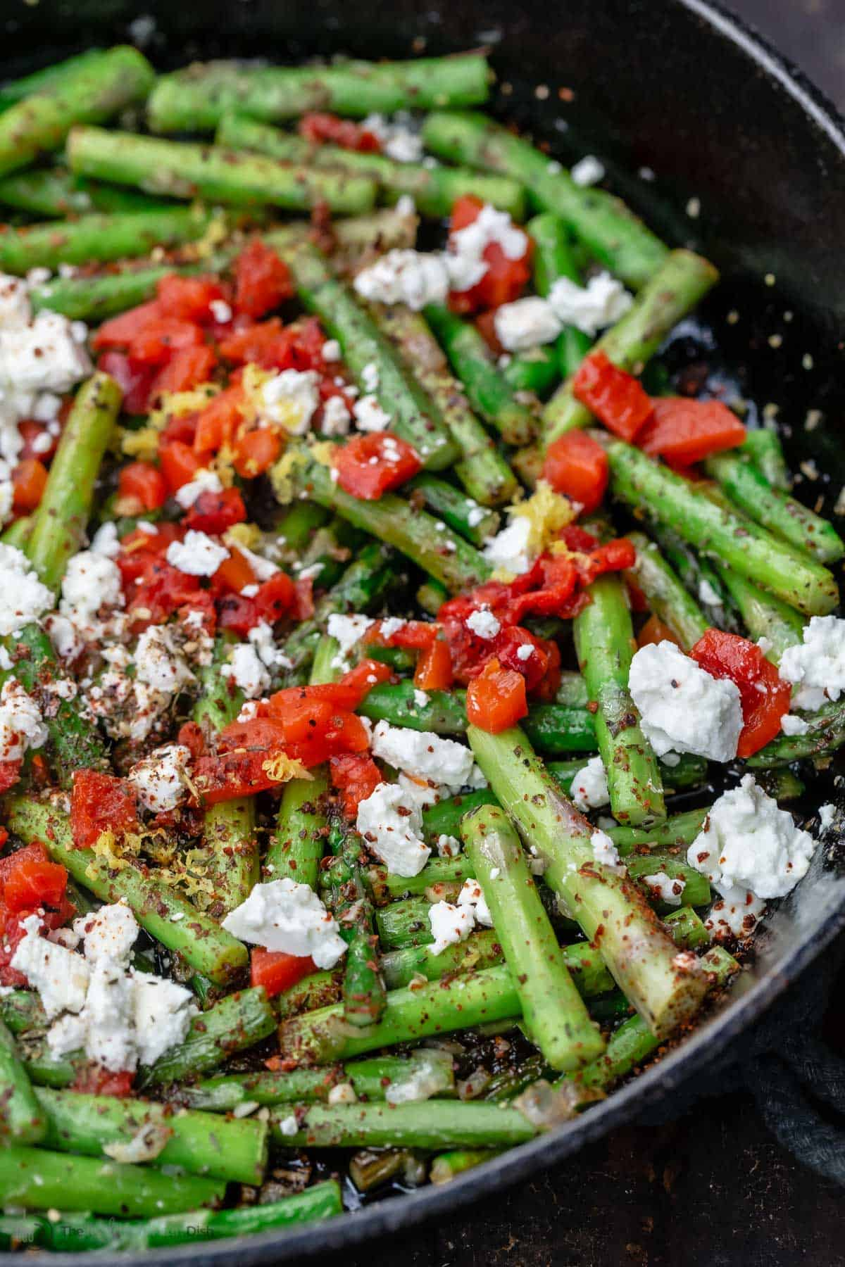 lemon garlic asparagus topped with feta and roasted red peppers