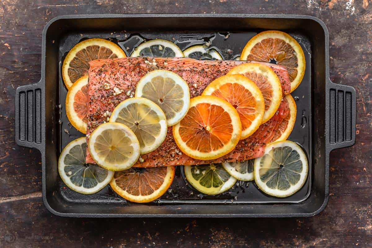 Raw fillet of salmon prepared in cast iron skillet