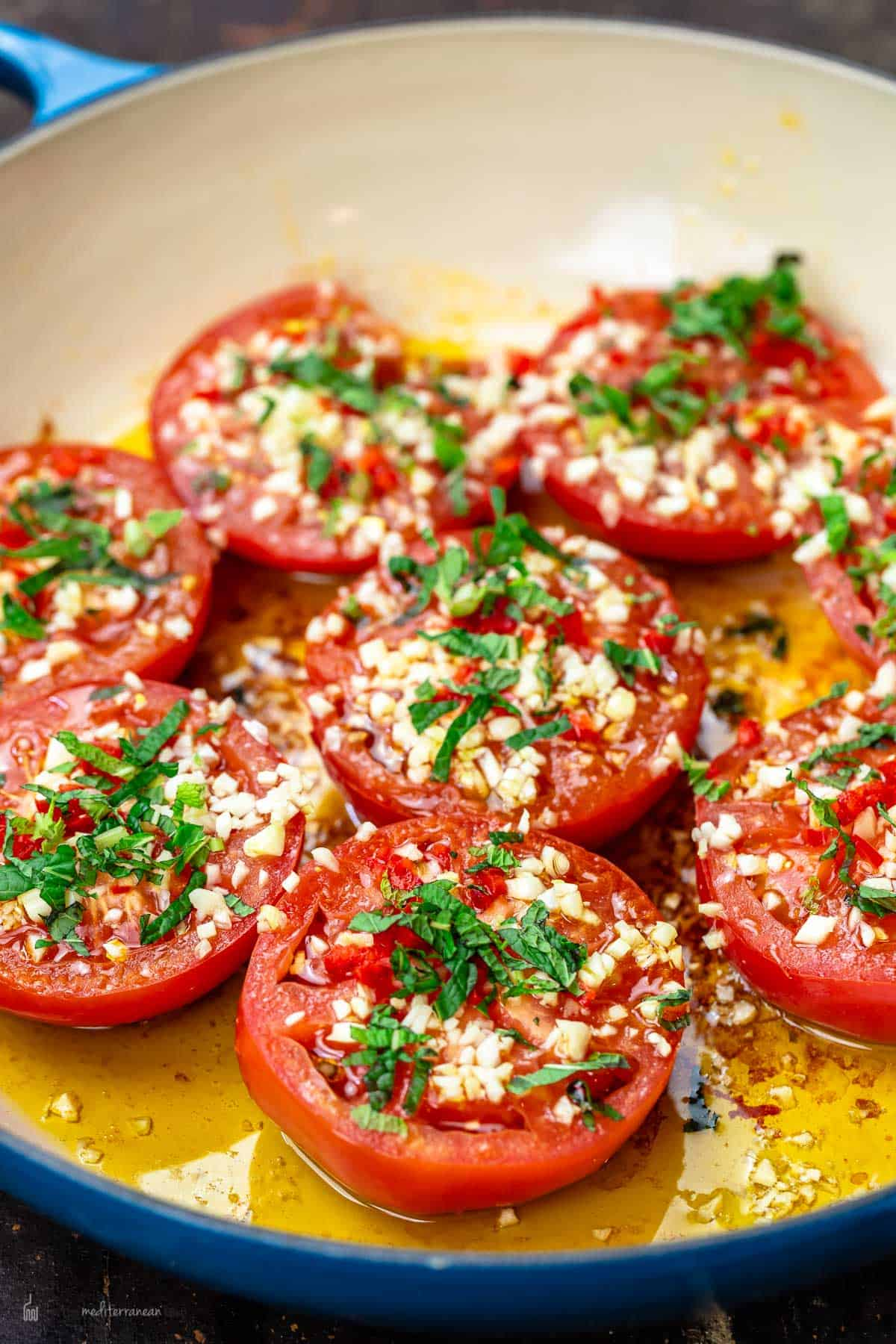 Fried tomatoes in frying pan