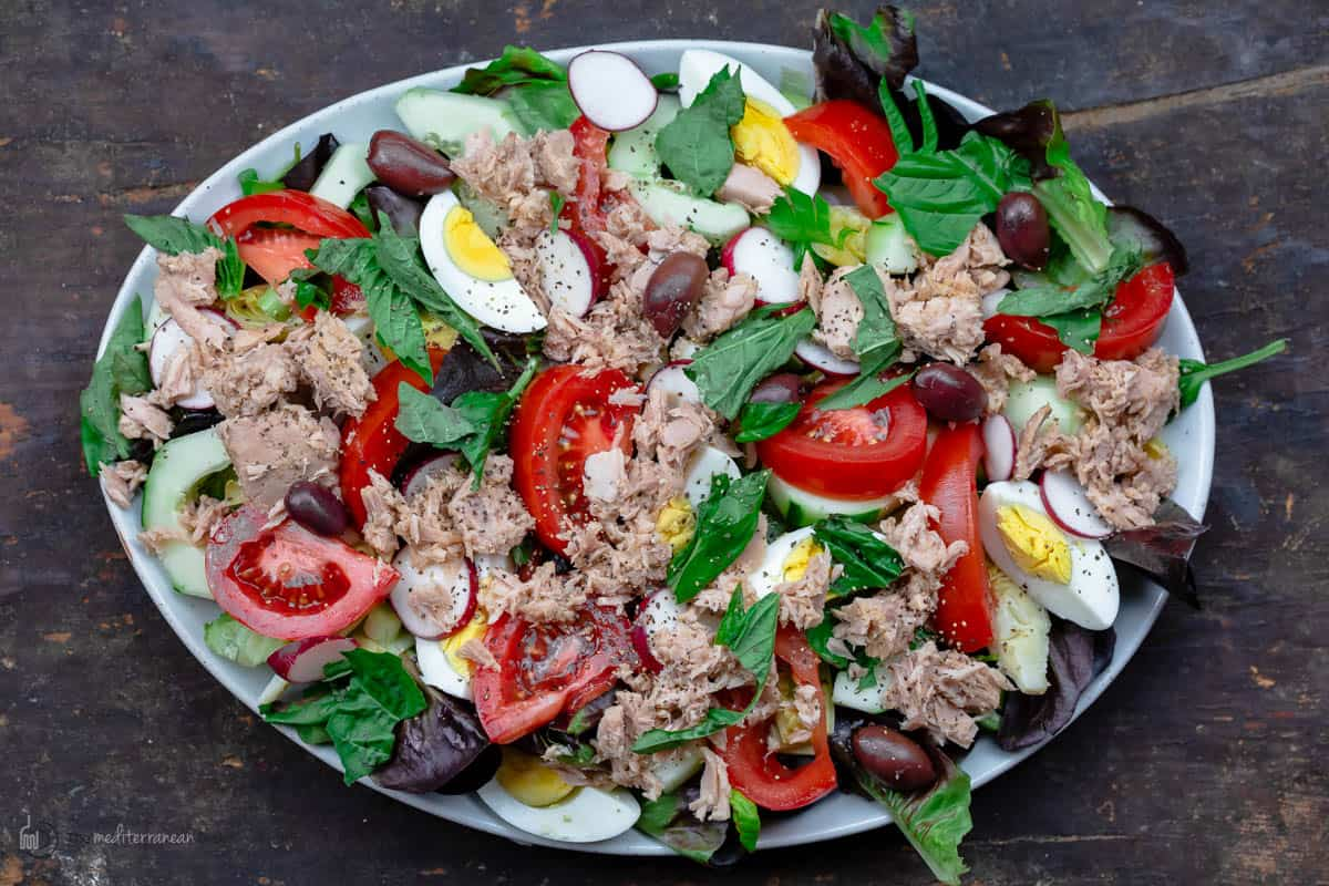 A Platter on a Picnic Table Holding a Fresh Nicoise Tuna Salad