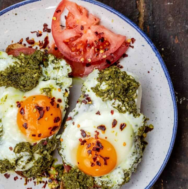Eggs with pesto on a plate
