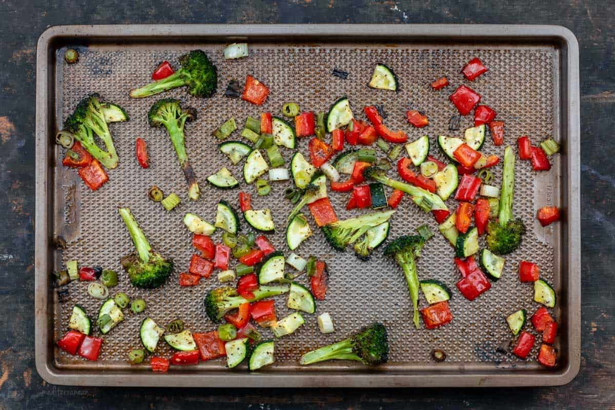 Roasted Bell Peppers, Zucchini, Green Onion and Broccoli on a Rimmed Baking Sheet