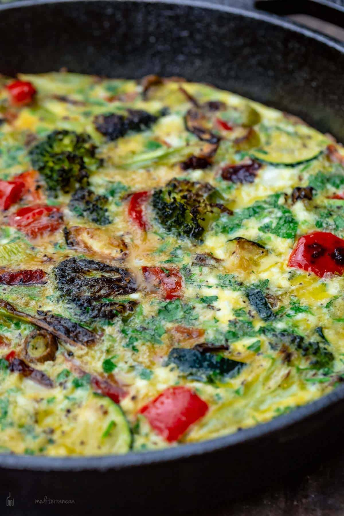A Close-Up Shot of a Vegetable Frittata in a Cast-Iron Pan