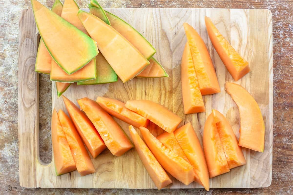 Sliced cantaloupe on a cutting board