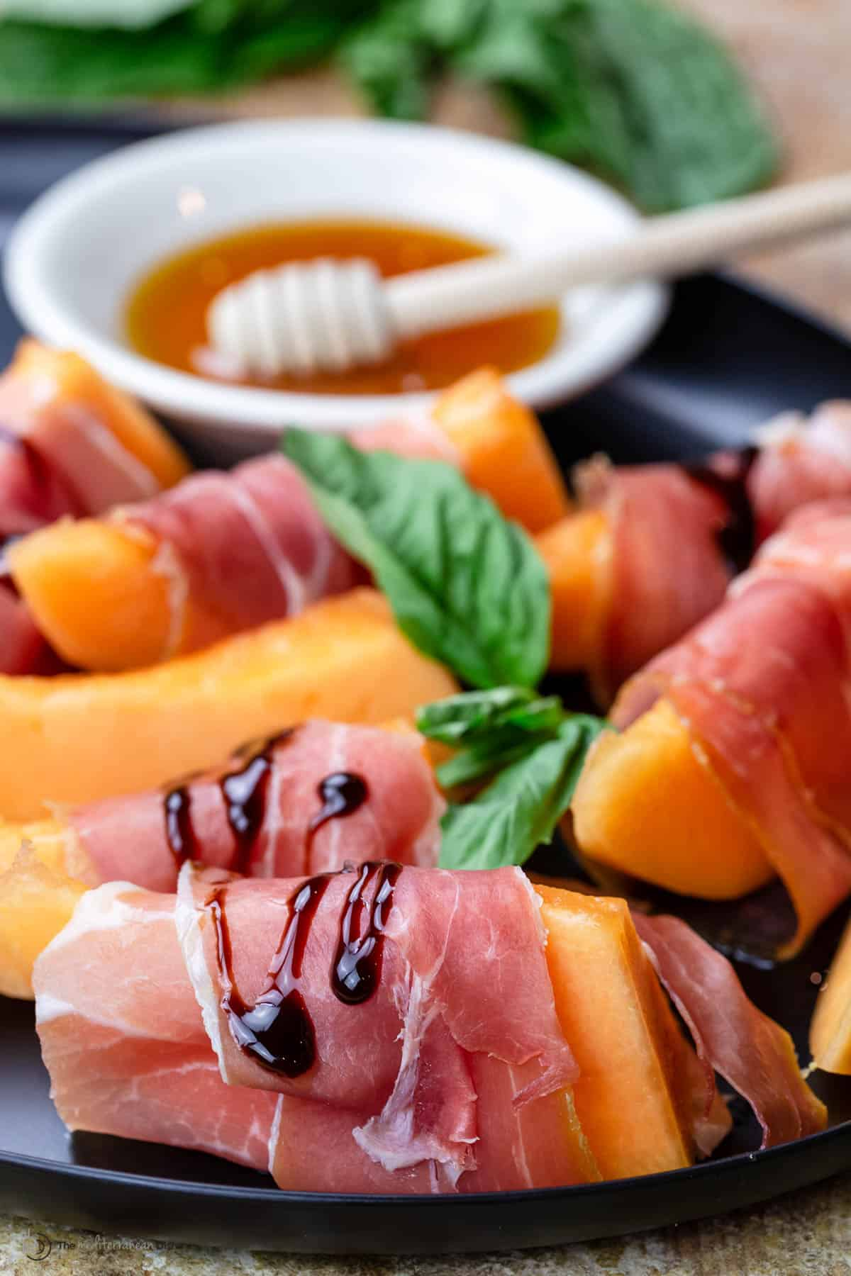 Prosciutto and melon served on a plate