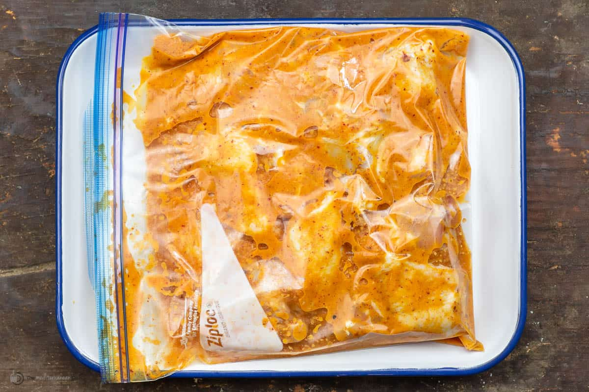 Chicken wings marinating in a ziploc bag