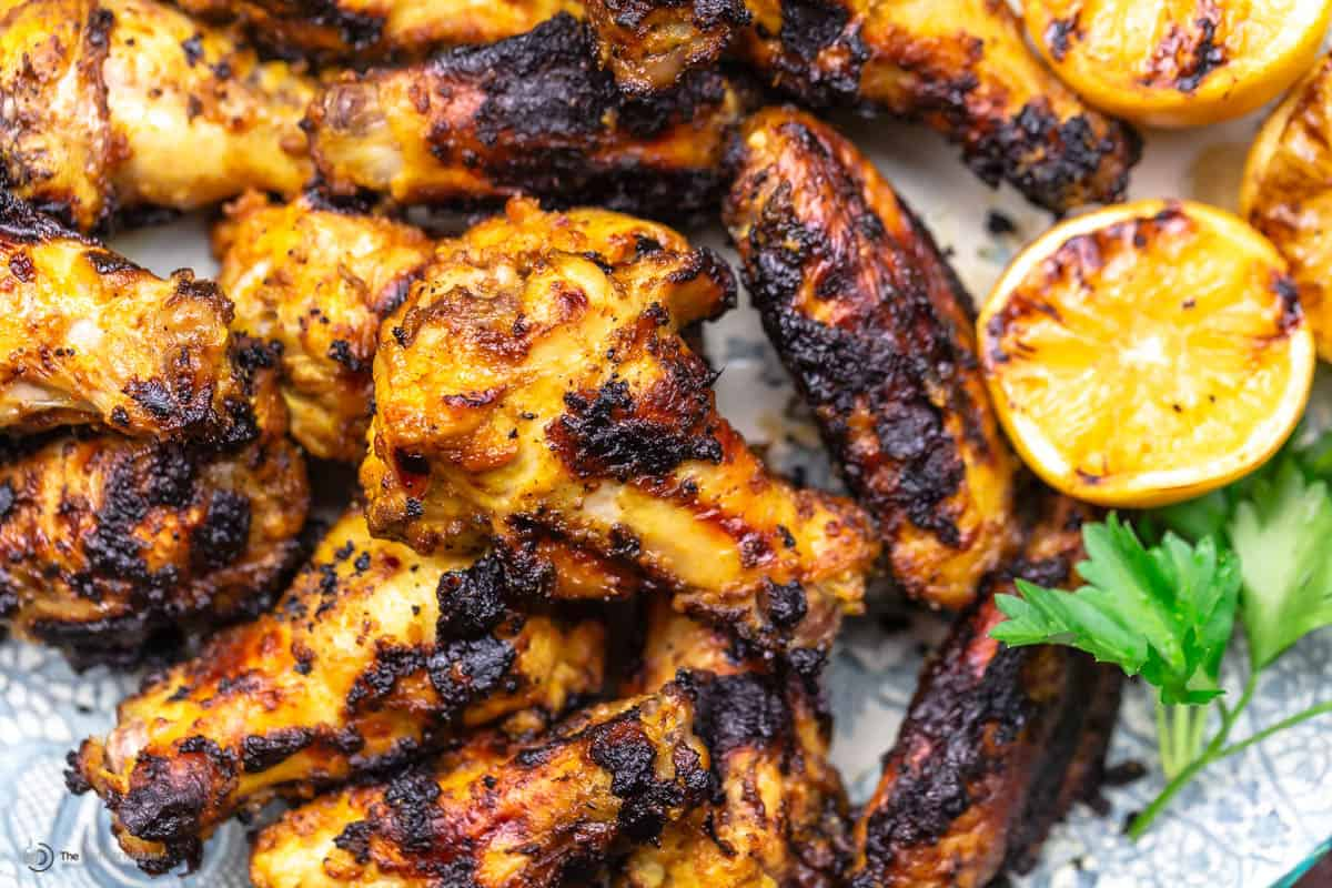 A close-up of grilled chicken wings