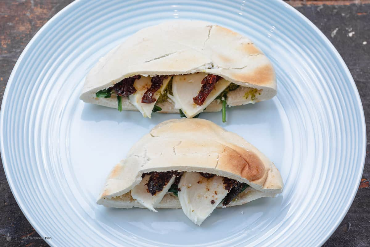 pita pockets stuffed with cheese, spinach, sundried tomatoes, and basil pesto