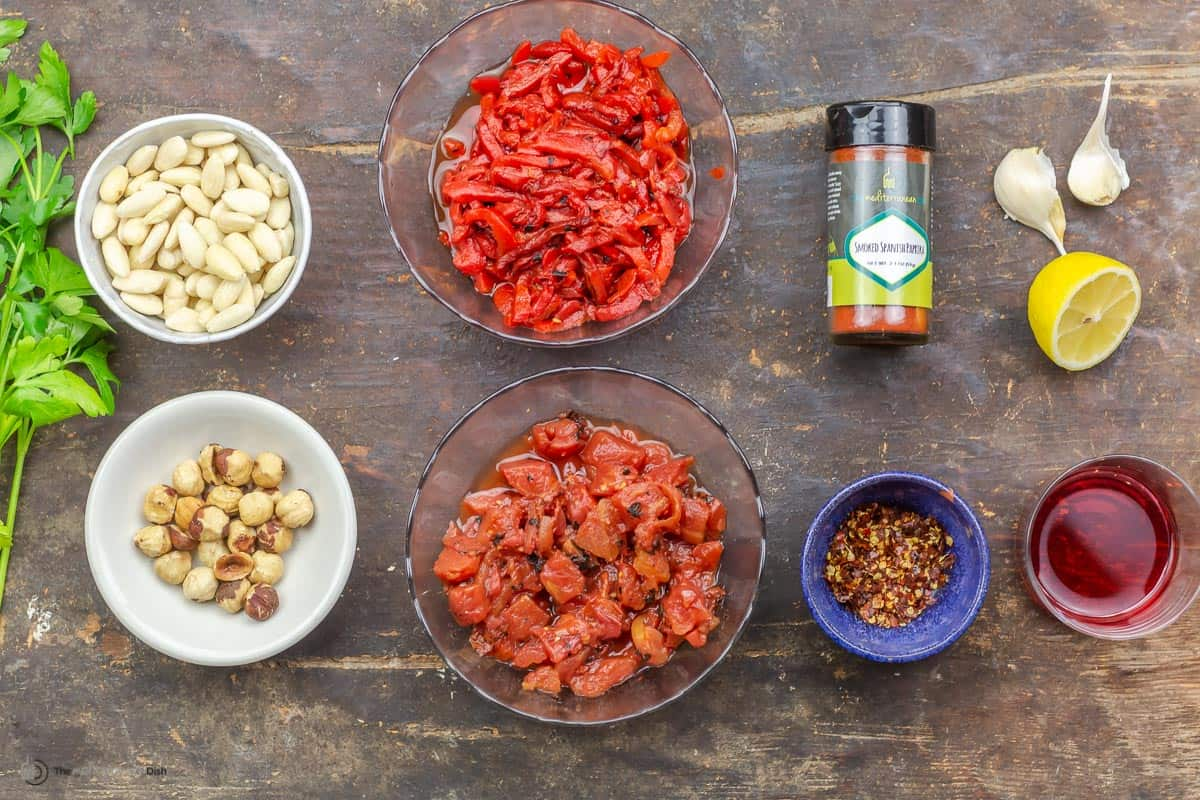 ingredients needed to make romesco sauce measured into small bowls