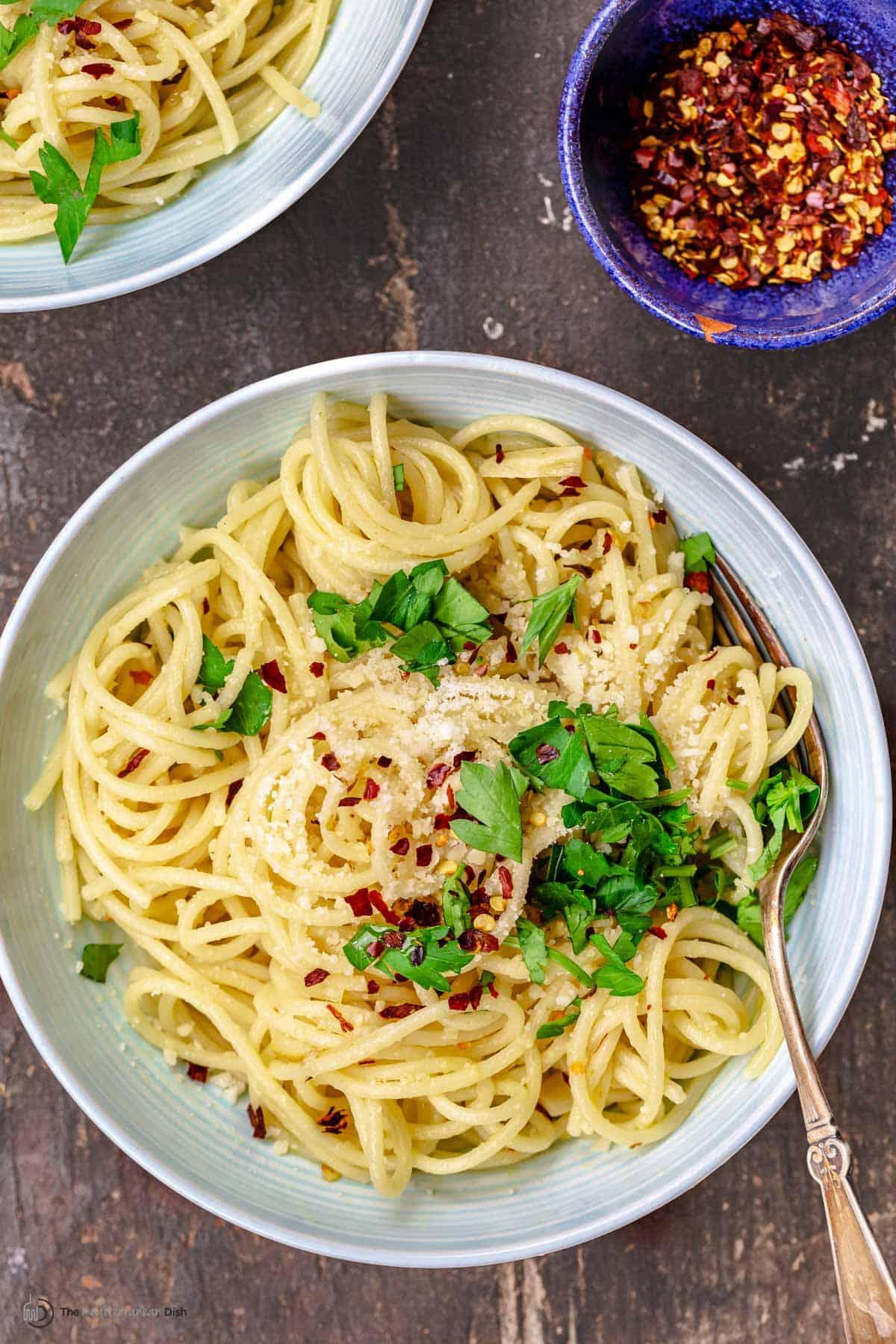 Aerial view of a big bowl of spaghetti aglio e olio