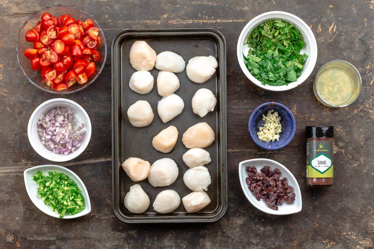 Ingredients needed to make Mediterranean-style salsa and grilled scallops