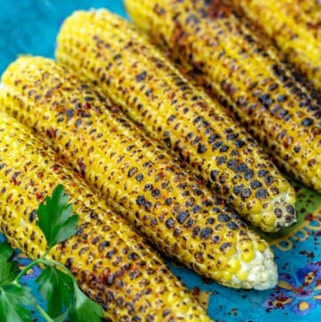 Slightly charred grilled corn on the cob topped with Aleppo pepper and lime