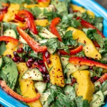 Savory mango salad on a blue plate