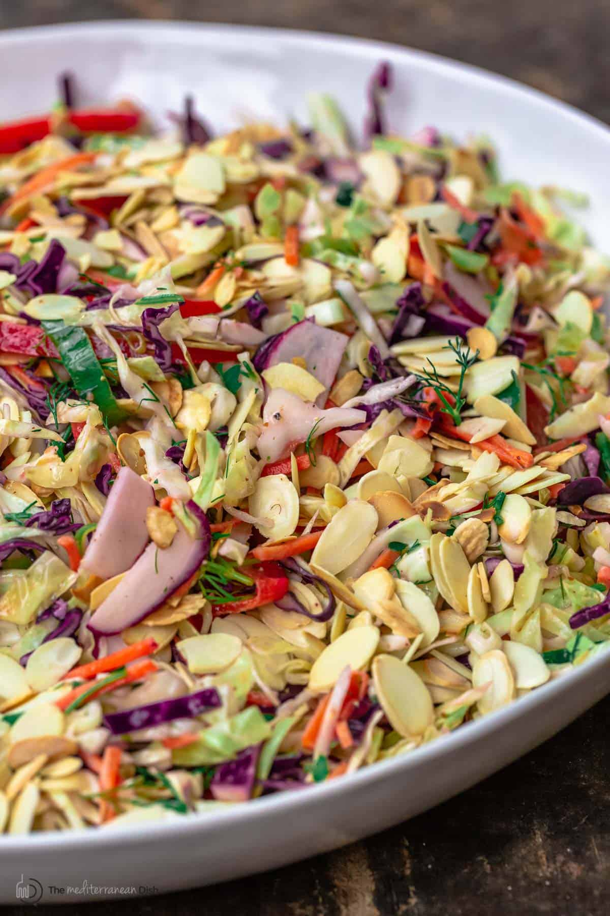 A close-up of a bowl of coleslaw without mayo