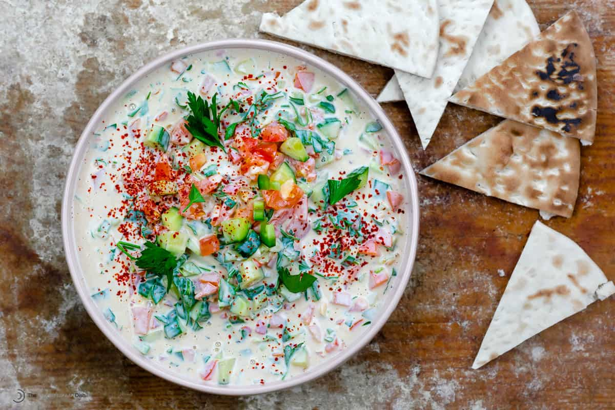 A bowl of Middle Eastern tahini salad with homemade pita chips