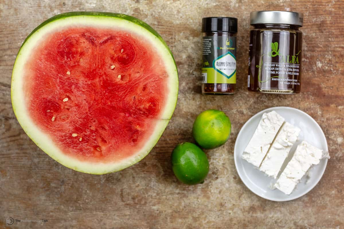 Half of a watermelon, lime, aleppo pepper, honey and feta