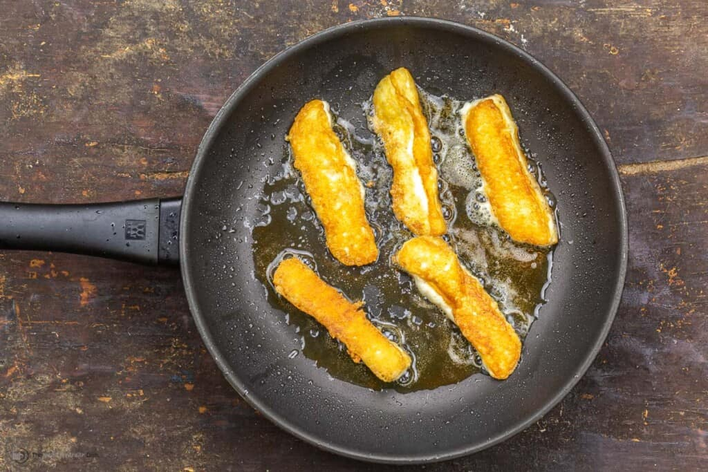 Halloumi fries in a skillet