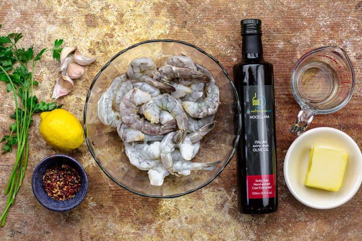 Parsley, lemon, pepper flakes, raw shrimp, olive oil, and butter