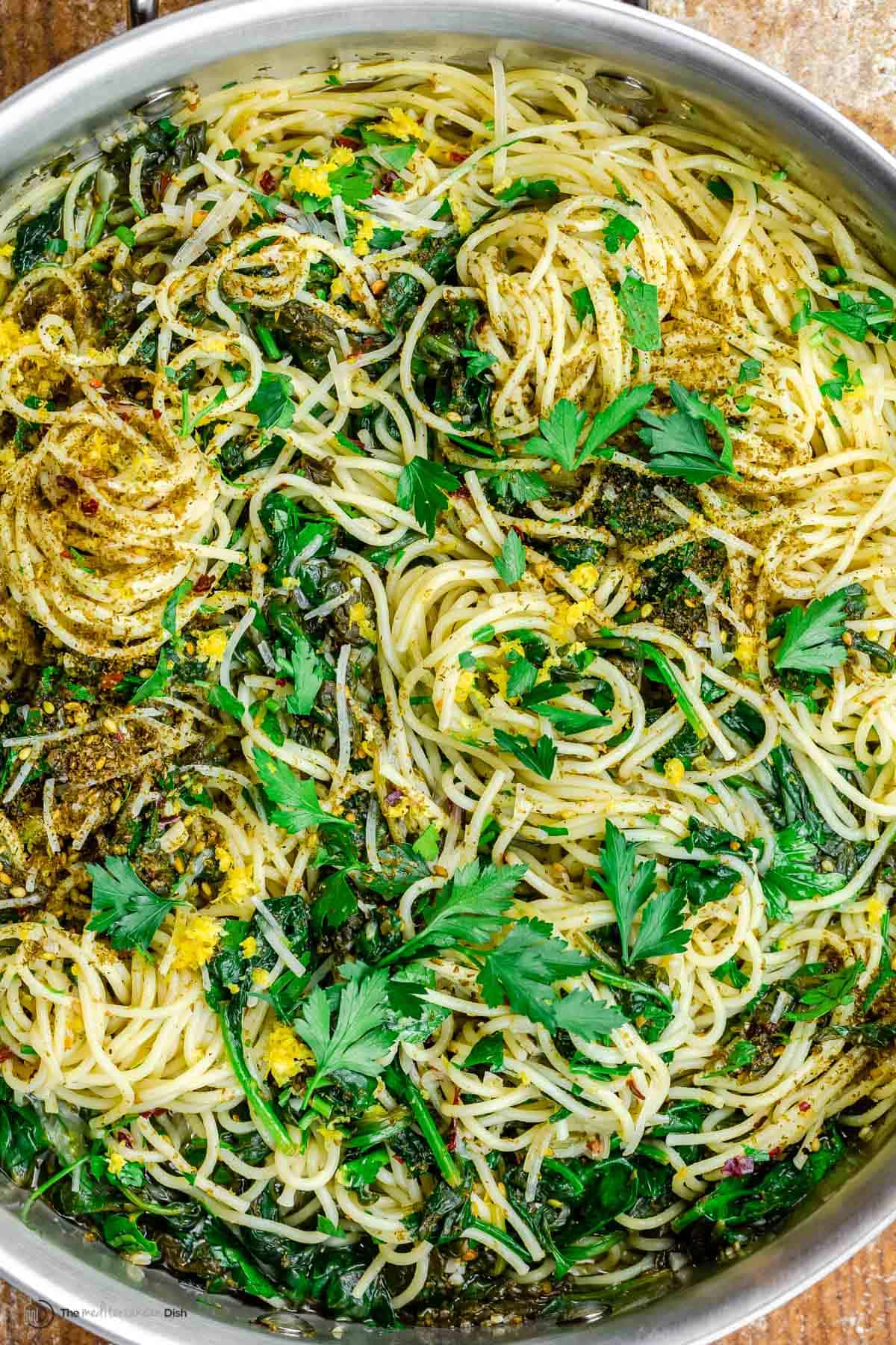 Close-up of garlic pasta with spinach