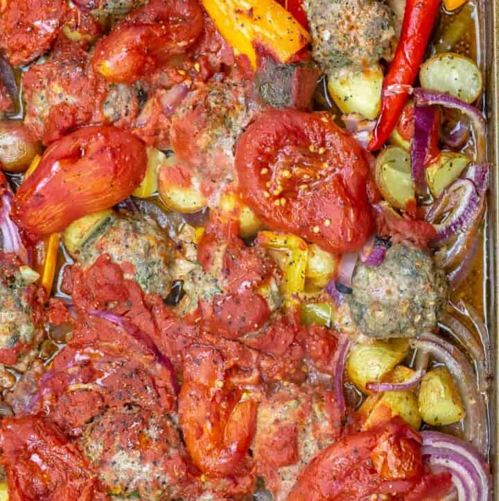 Baked meatballs with vegetables and tomatoes