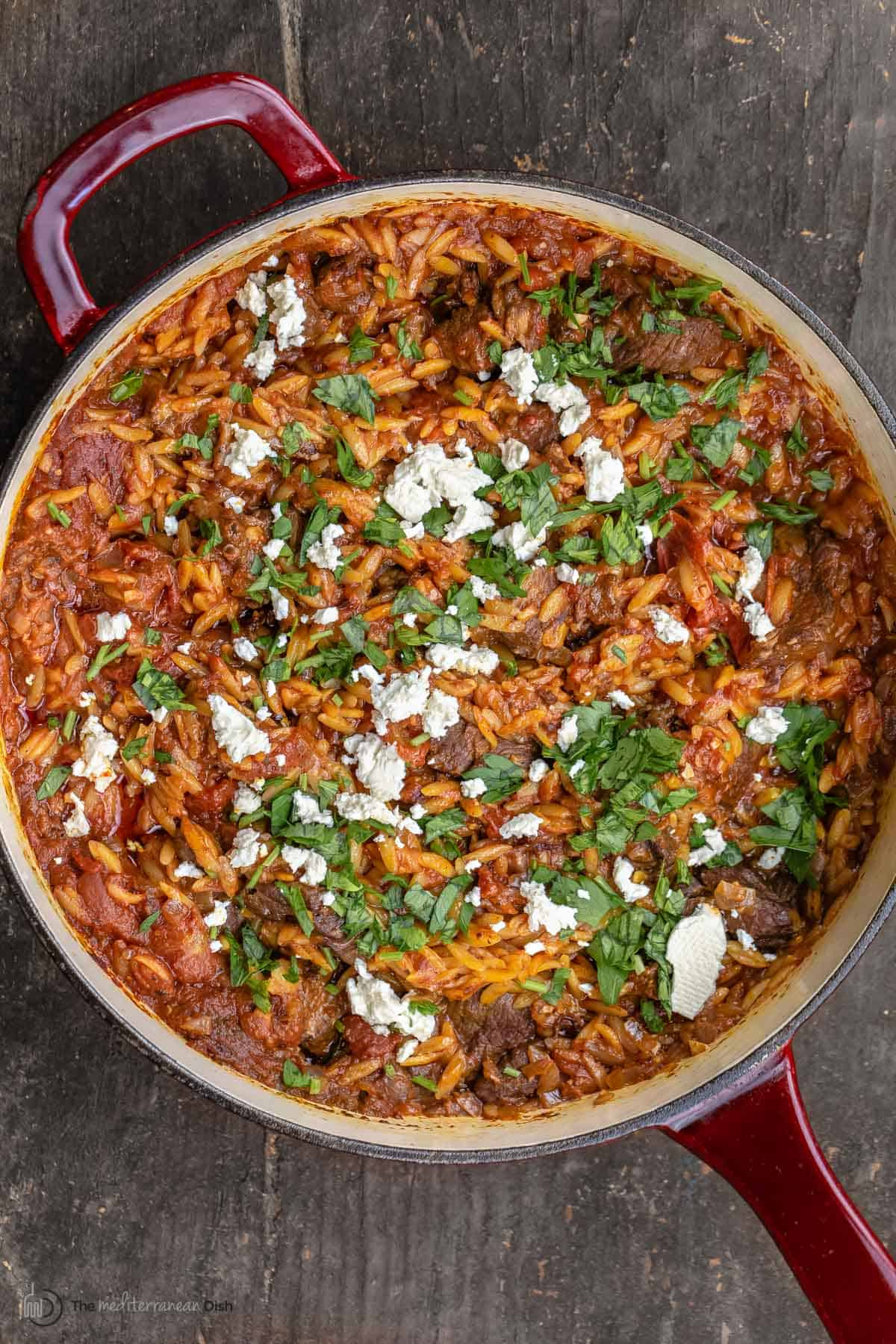 Youvetsi greek lamb stew topped with feta and parsley